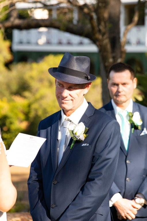 Groom wearing a hat and best man