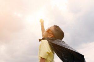 Kid in super hero cape | Olive Rose Weddings & Events